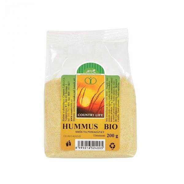 hummus spreads the mixture on Bio Country Life